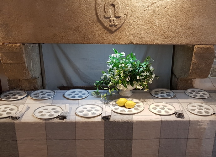Enjoy oysters alfresco on a french woven linen dressed table and jasmin flower bunch